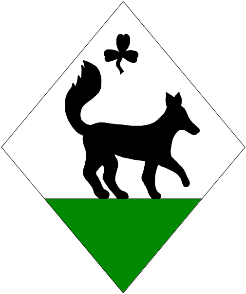 [Argent, a fox passant contourny sable atop a base vert, in chief a trefoil slipped sable]